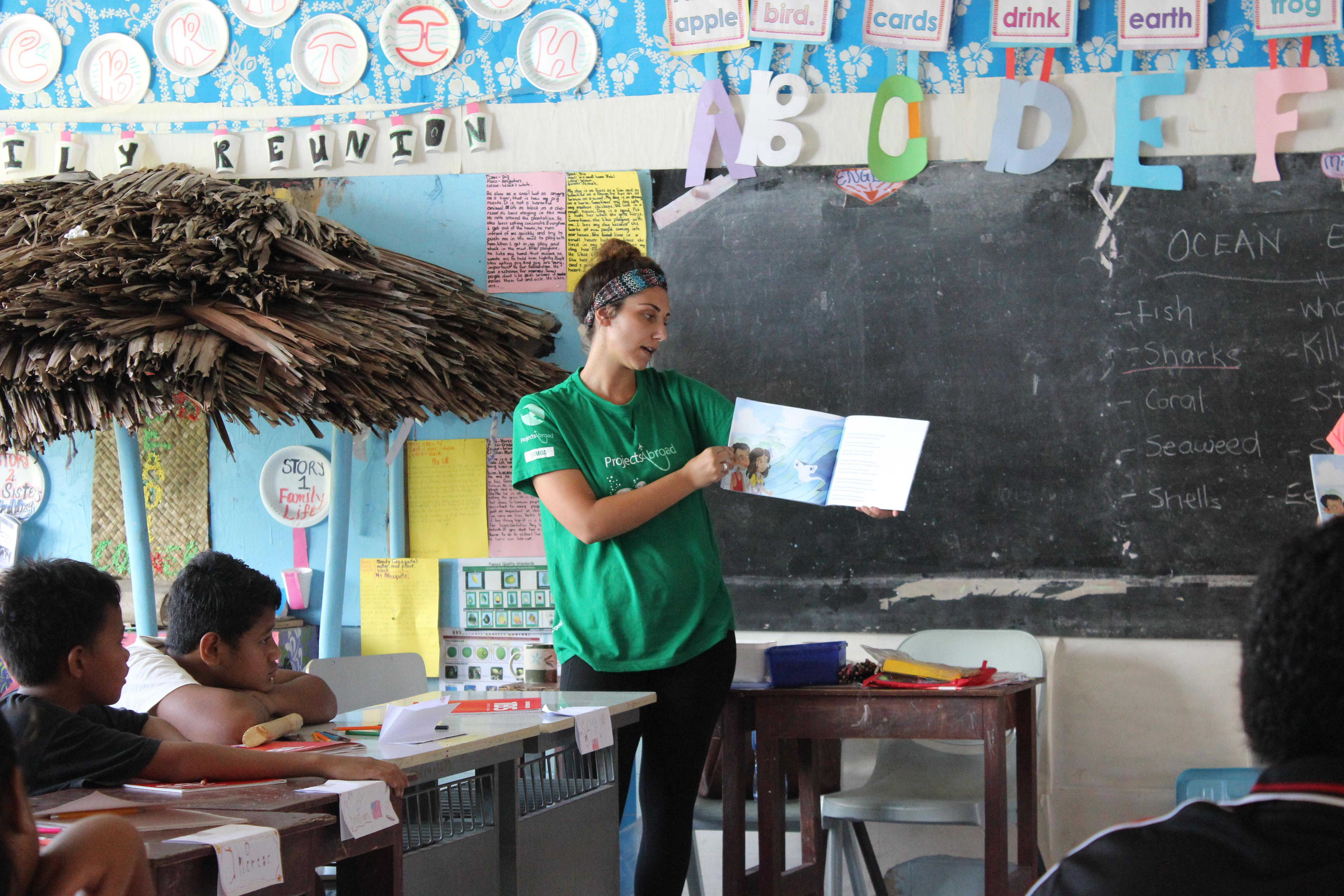 A community volunteer for teenagers in Samoa hosts a lesson
